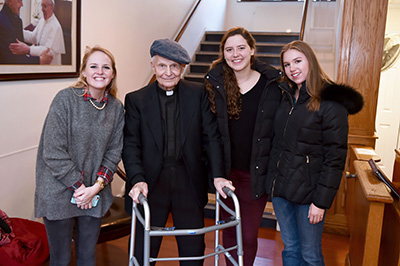 George Restrepo, S.J. (second from left) with Fordham student volunteers (from left) Dylann Keaney, Laura Lynch, and Juliette Dixon.