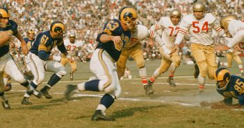 A 1950s action photo of offensive lineman John Hock (Number 63) plying his trade for the Los Angeles Rams.