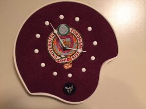 A football helmet clock in Pettenati's collection of Fordham memorabilia