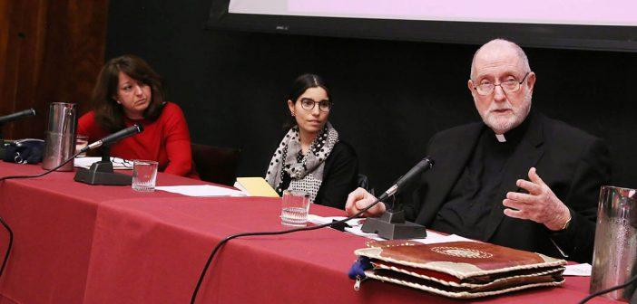 Ebru Turan, Sarit Kattan Gribetz and Patrick Ryan, SJ, seated at a table in the tweflth floor lounge