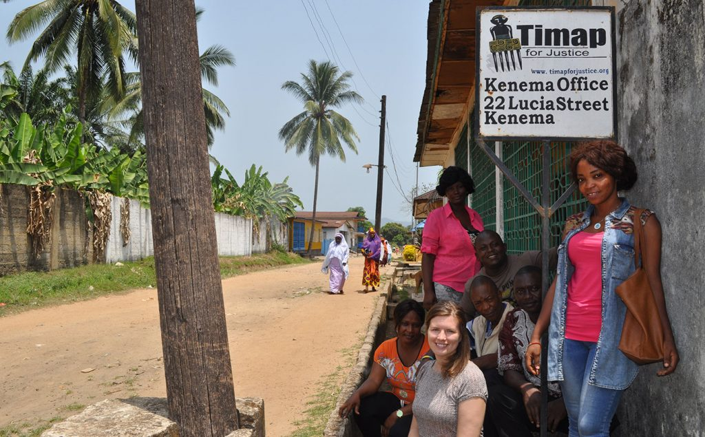 Frazier and members of Tmap at the organizations' office in Kenema, Sierra Leone.