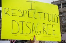 A sign at a recent protest march that says I respectfully disagree