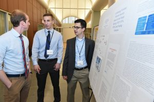 "Computer science majors Luke Johnston and Chris Mallozzi present their research, ""Combating Wireless Network Security Issues for the Future"" at the 2017 Undergraduate Research Symposium. (Photo by Dana Maxson)"