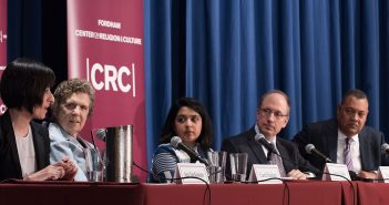 Ani Sarkissian, Carol Keehan, Asma Uddin, Thomas Berg, and Vincent D. Rougeau, sitting at a table on stage at the Pope Auditorium, at Fordham's Lincoln Center campus