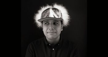 "Fordham alumnus Anthony Iliakostas wearing what he likes to call his ""thinking cap,"" an Albert Einstein wig hat"