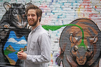 "Fordham doctoral candidate Matthew Combs at the ""Street Art for Street Rats"" event he organized to help educate the public about the ecology of rats."
