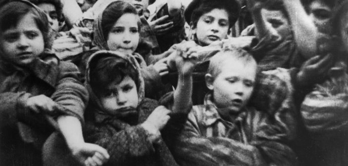 This image of child Holocaust survivors, including 4-year-old Michael Bornstein (in front on the right), is from film footage taken by Soviet soldiers days after they liberated Auschwitz on January 27, 1945. Courtesy of Pańtswowe Muzeum Auschwitz-Birkenau