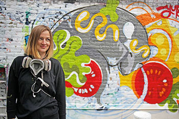 "Graffiti artist Yu-baba with her mural in progress at ""Street Art for Street Rats."""
