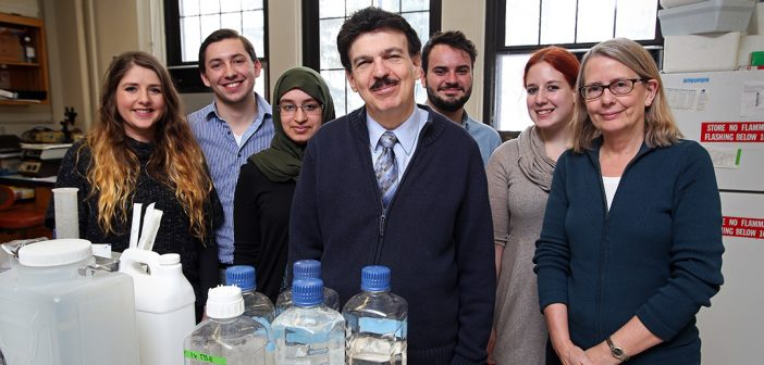 Berish Rubin, Sylvia Anderson and Fordham students pose for a picture in Dr. Rubin's biology lab.