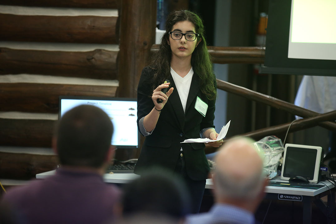 "Merve Karakaya presents her research, ""Identifying fungal species in the undisturbed and disturbed woodlands of Van Cortlandt Park"" at the 2017 CSUR Symposium."
