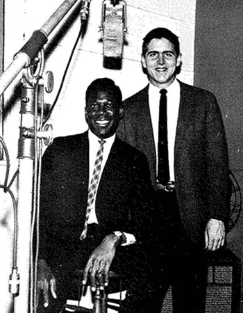 A photo from the 1965 Fordham Maroon yearbook shows Peter Carter in the WFUV studios with Dan McAuliffe. Carter was the radio station's sports director at the time; McAuliffe was assistant sports director.