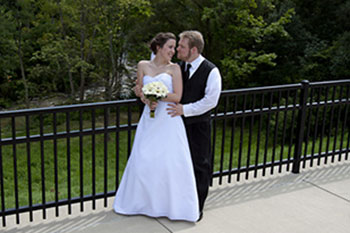 Rog and Lucas, wearing a wedding gown and tuxedo, respectively, in Buffalo, New York, on their wedding day, August 27, 2011.
