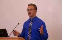 Political professor Nicholas Tampio standing at a podium at Fordham Law School