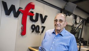 Bob Ahrens, who has trained Fordham students for sports media careers for 20 years, stands in the studios of WFUV, Fordham's public media station.