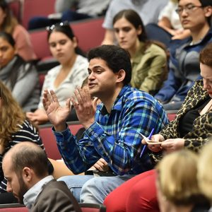 Student asks question at Higgins Clark lecture