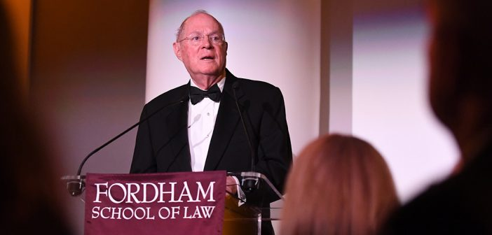 Supreme Court Justice Anthony Kennedy speaks from a podium at Fordham's School of Law