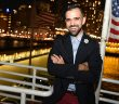 Justin LaCoursiere, president of Fordham's Young Alumni Committee, on Pier 81 prior to the Young Alumni Yacht Cruise, a three-hour dinner party and tour of New York Harbor that attracted approximately 300 guests.