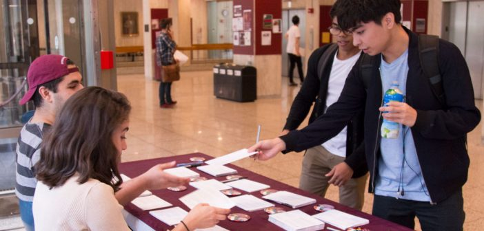 Students participate in a collaborative effort on campus to collect signed postcards in support of the DREAM Act, to send to U.S. congressmen in Washington D.C.