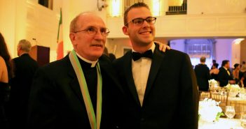 Father McShane with award medal