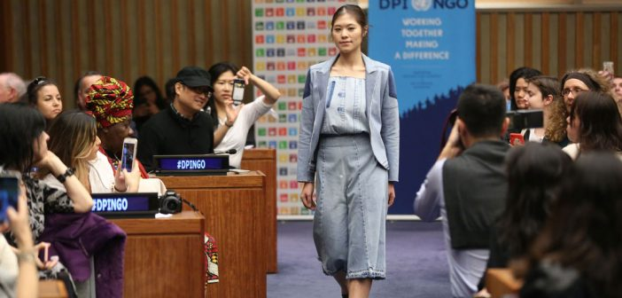 A model showcases sustainable fashions at the United Nations in New York on November 26, 2017.