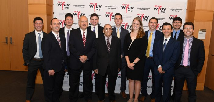 WFUV sports producer Bob Ahrens, center, was honored with a special tribute featuring award-winning student staff.