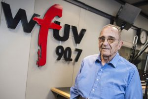 Bob Ahrens in the WFUV studios, where he oversaw the sports department for two decades. (Photo by Dana Maxson)