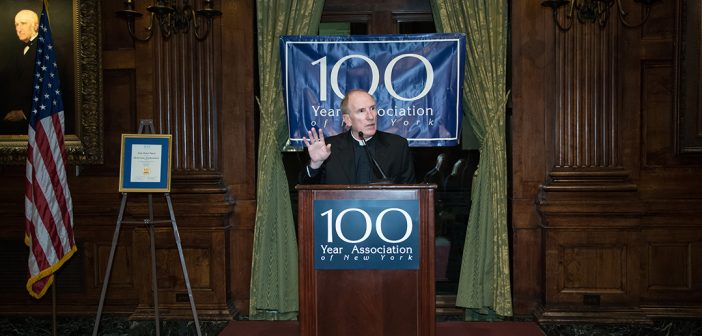 Joseph M. McShane, SJ, speaks from a podium at the University Club