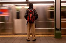 Commuting Student standing on subway platform