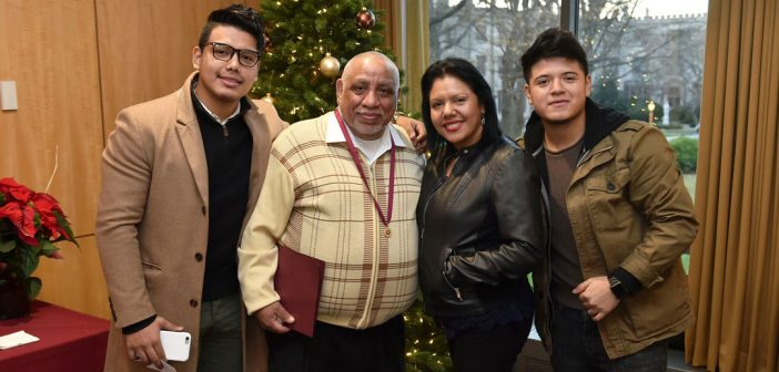 Awardee Milton Domenech, second to the left, is joined by wife and two sons, Erick (L) and Mauricio (R).