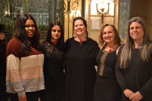 "Fordham English professor Keri Walsh (center) with three of her students (from left), Chenelle Simpson, Zainab Shaikh, and Lauren Beglin, and Jean Hanff Korelitz, co-author of ""The Dead, 1904,"" at the American Irish Historical Society."