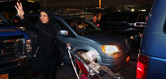 Fahimeh (Farimah) Kashkooli waves goodbye as she and Alma leave the airport.