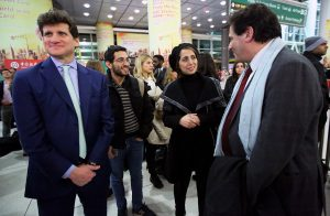 Gordon Caplan '91, Amir Fadavi '17, Fahimeh Kashkooli, and Dean Matthew Diller await the arrival of Kashkooli's daughter.