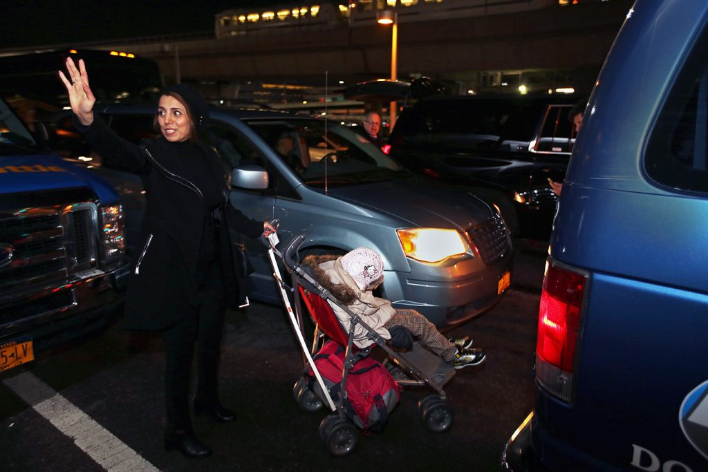 Fahimeh Kashkooli waves goodbye as she and Alma leave the airport.