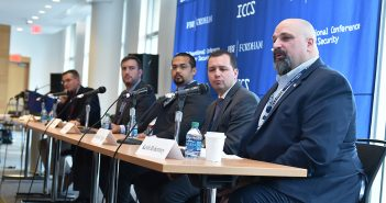 Jake Schmitter, Adam Marlatt, Keith Robertory, Michael R. Singer, and Ron Snyder, sit for the panel Connectivity and Cyber Safety in Natural Disaster Zones