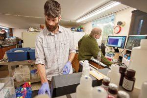Stephen Gottschalk (left) and John Wehr analyze algae samples in the McCarthy Lab