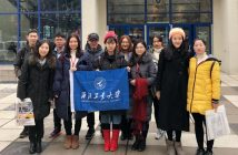 NPU Students from China in front of Fordham Logo