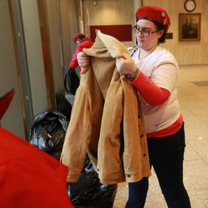 Borghard inspects donated jacket