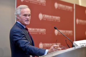 Scott Pelley addresses an audience at Fordham Law