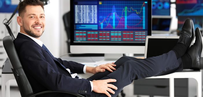 Stockbroker with feet up on desk