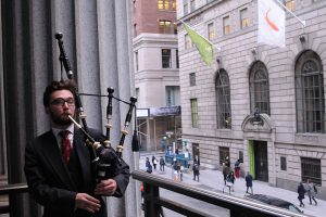Fordham bagpipes over Wall Street.