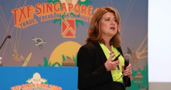 T. Dessa Glasser speaks at a conference in Singapore