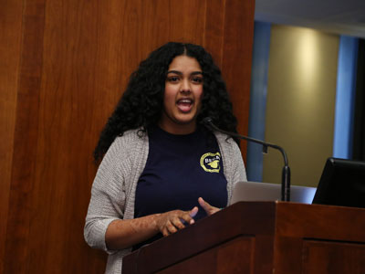 High schooler Alesha Alli reads her poetry at the podum at Poets Out Loud reading on April 11