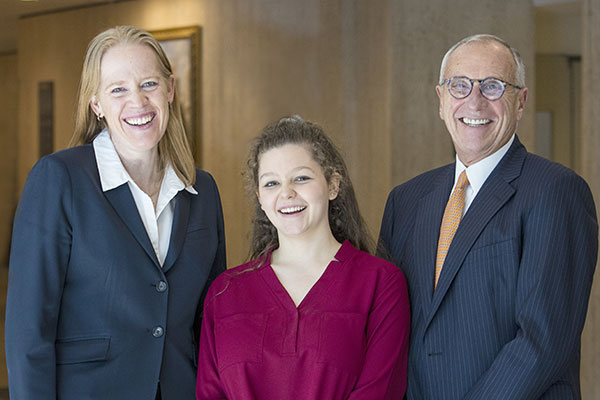 Longtime Fordham benefactor John Toffolon (right), a former University trustee, with two beneficiaries of the scholarship he and his wife established in 1995: Cindy Vojtech (left), the inaugural Toffolon scholar, who is now a principal economist at the Fed; and Samantha Barrett, a first-year student at the Gabelli School.
