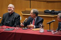 Father Patrick Ryan talks with Rabbi Daniel Polish and Professor Zaki Saritoprak at a long table with microphones at the 2018 McGinley Lecture on the Rose Hill campus