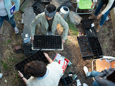 Students prepare seed-starting trays in St. Rose's Garden.