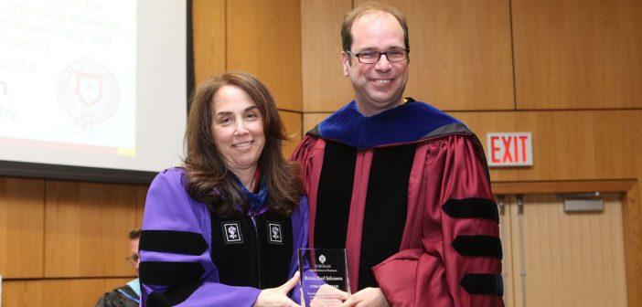 (L-R) Donna Rapaccioli, Ph.D., dean of the Gabelli School, with Brian E. Johnson, Ph.D., a recipient of Faculty Cura Personalis Award.