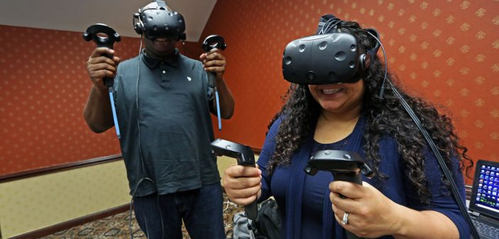 The 2018 cohort of the Executive MBA (EMBA) program at the Gabelli School of Business in Westchester participate in VR/AR exercises focused on teamwork and communication. Photo by Bruce Gilbert