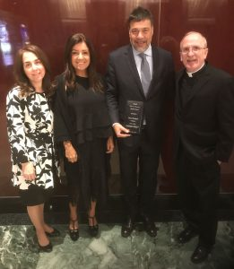 (L-R) Donna Rapaccioli, Ph.D., dean of the Gabelli School, Cecilia Werthein, Alumni Award recipient Dario Werthein, GABELLI '91, and Joseph M. McShane, S.J., president of Fordham at the 2018 graduate awards brunch on May 14.