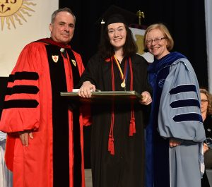 Claver Award winner Meghan Townsend, with , Thomas Scirghi, SJ, left, and Maura Mast, right