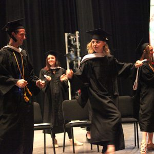 Graduates celebrate at the conclusion of the ceremony.